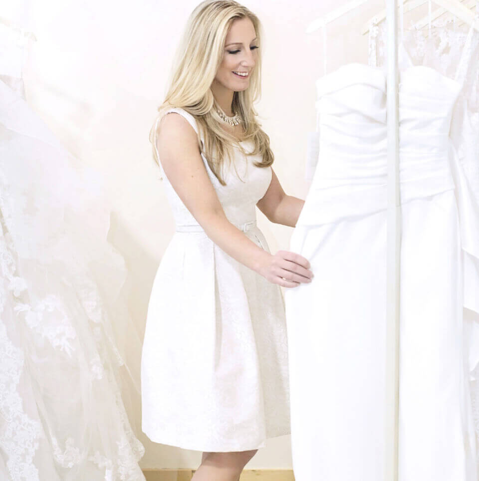 Photo of customer looking at bridal gowns